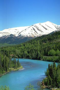 Kenai river in Alaska. I've been here and yes, the water really is this color. I was told it's  because of all the copper.