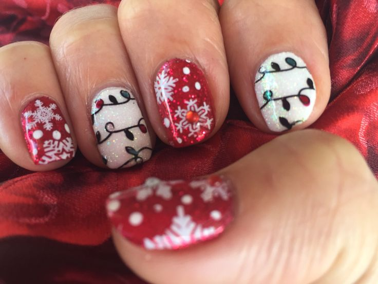 Shellac wildfire and cream puff with magpie ruby and blossom glitters. MoYou stamping and gems.