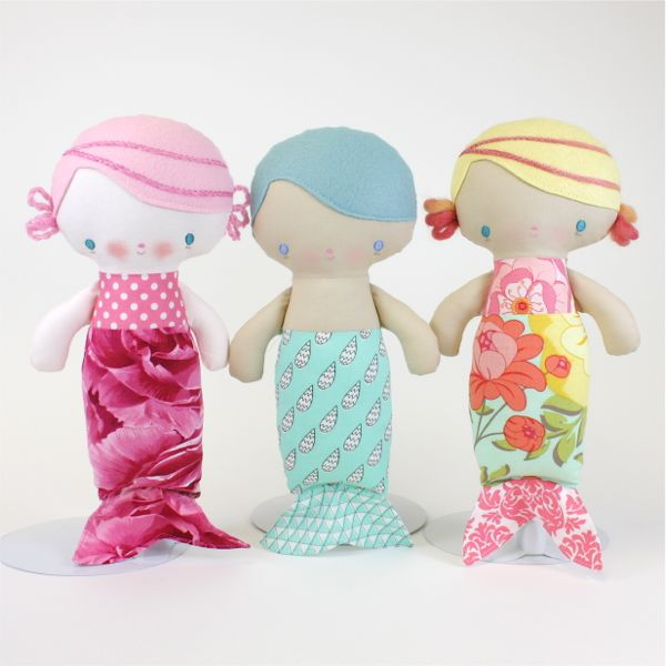 This site has, hands down, the cutest freakin dolls ever!  You can buy the pattern for $10 or finished dolls and clothes.  I would love to have a mermaid doll of my own!Baby Mermaid PDF Pattern.