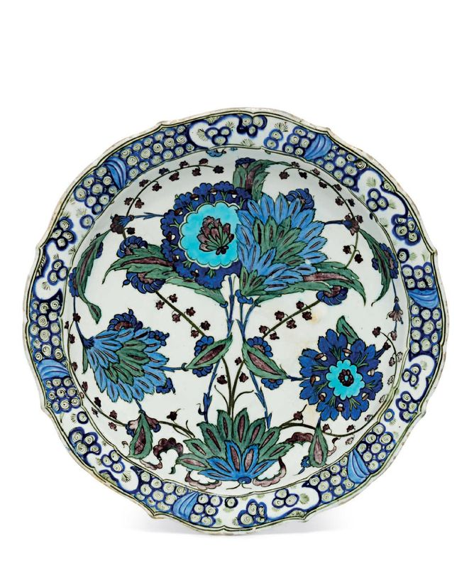 An important 'Damascus-Style' Iznik pottery dish, attributable to 'The Master of Hyacinths', Ottoman Turkey, circa 1555