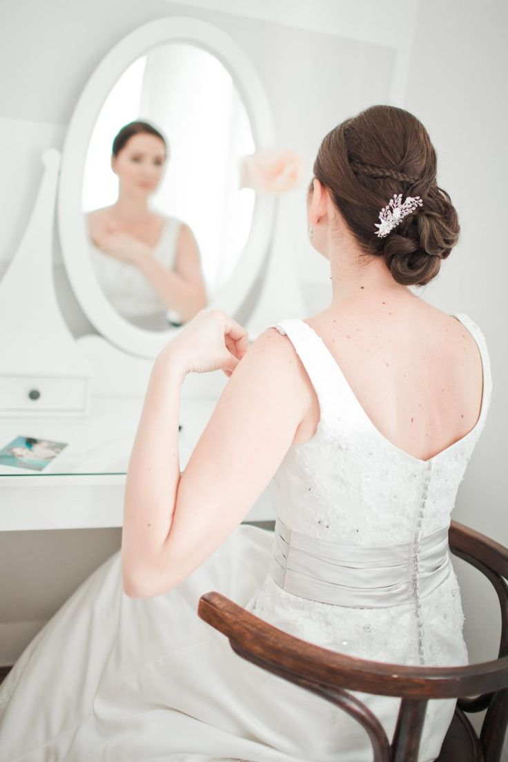 Getting ready. Bride and mirror