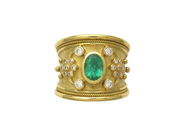 An 18ct yellow gold tapered Templar ring featuring a fabulous oval faceted Paraiba tourmaline (1.06cts). The ring is decorated with four round brilliant cut diamonds (0.21cts in total) set around the central stone and an additional fourteen round brilliant cut diamonds (0.20cts in total), flower motifs, and gold bead detail.  The ring is finished with a wire-twist-wire edge.