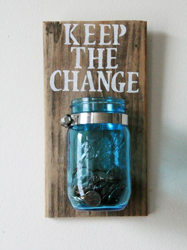 Katherine at the ShopOneLove Etsy store creates these rustic pieces — a mason jar mounted to painted wood — to collect odds and ends before they accidentally hit the wash. Buy it here »