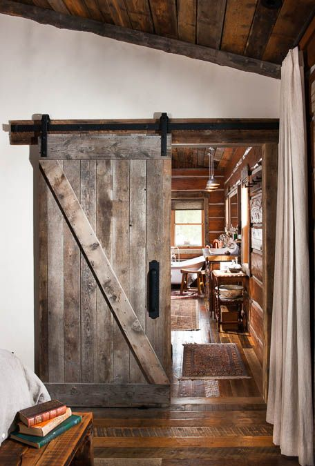 I'm sold on Barn doors as space savers and statement pieces. I like the stark difference between the white wall and distressed wood. The heavy black bracket just makes me think European Country Side.