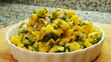 """Mango is one of my favorite fruits. The color, flavor and texture are all great. And mango is also a bit on the """"exotic"""" side, so whenever I make it for guests, they think I'm really cool (hard to believe I know). In this recipe, I show you how to make a fresh mango salsa that is absolutely great on its own (maybe with some chips), but I also love it as a sauce for fish, chicken and pork – or even as a garnish for fish tacos. There's no cooking involved, so it only takes…"""