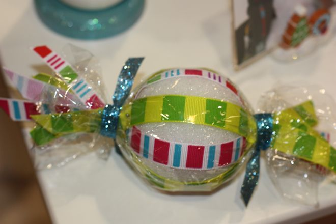 "Pin ribbons along a styrofoam ball and then wrap in cellophane for a decorative holiday ""candy""!"