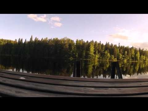 Traditional view of the lake during midsummer in Finland. (timelapse)