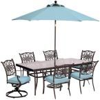 Hanover Traditions 7-Piece Outdoor Dining Set with Rectangular Glass Table, 2 Swivels, Umbrella and Base with Blue Cushions