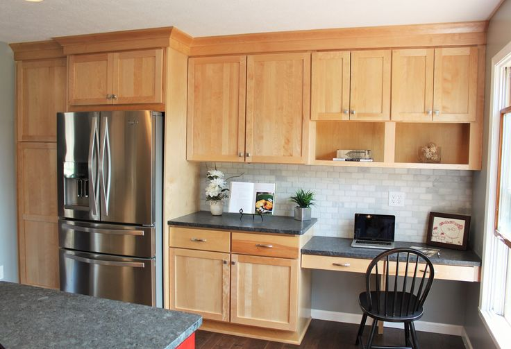 Kitchen desk area, shows a shaker door in natural birch, cabinets by Bertch Marketplace.