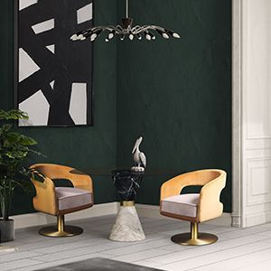 Ellen is a fanciful dining chair full of luxurious features. Its distinctive open curved back is extremely sculptured and it contrasts with the slim legs made of polished brass. It is upholstered in velvet and has mixed tones both on the back and the round cushioned pad.