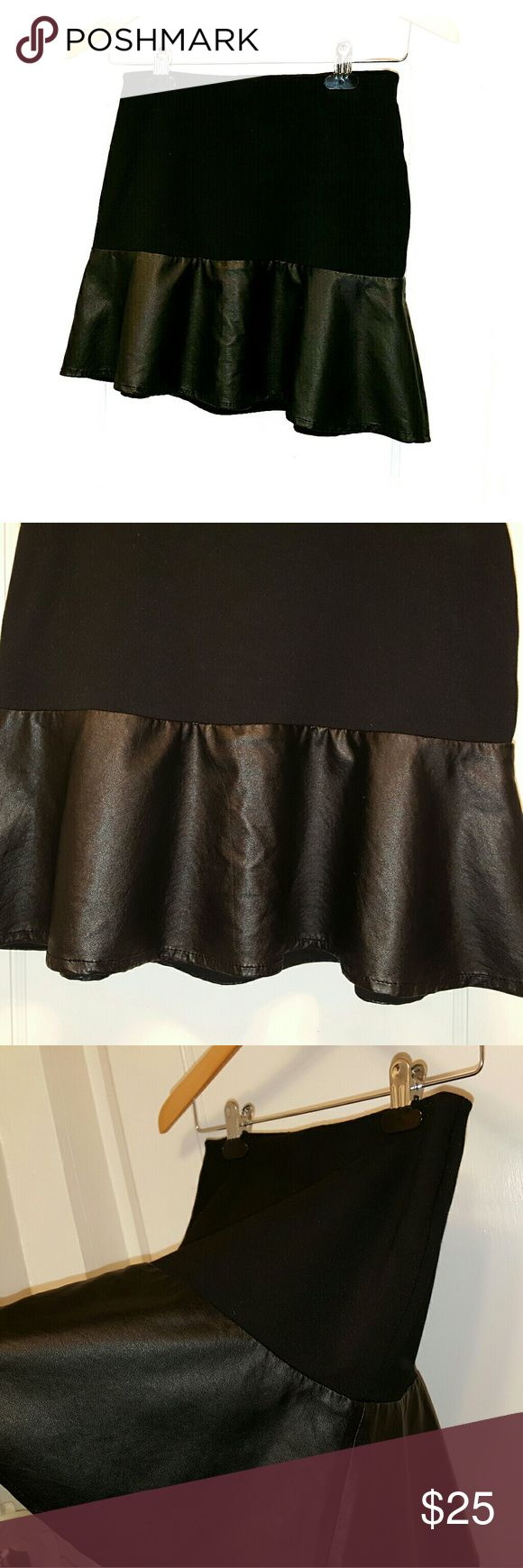Sally Miller blk knit and faux leather mini NWOT This skirt is a size XL in GIRLS, but I find it fits just like and XS 0/2. NWOT.  Never worn,  only tried on.  I just have so many similar skirts.  Lol.  Black mini skirt with comfortable stretch waistband and knit like top portion,  with a free open,  ruffling faux leather panel at the bottom.  By Sally Miller. Sally Miller Skirts Mini