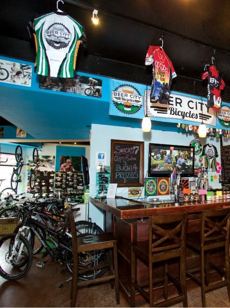 """Beer City Bicycles in Asheville ... a new kind of """"Biker Bar"""" - You can shop for a new ride or belly up to the bar or even get in a little midday exercise on a row of Computrainers   WNC Magazine"""