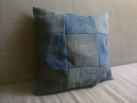 a pillow made of recycled jeans