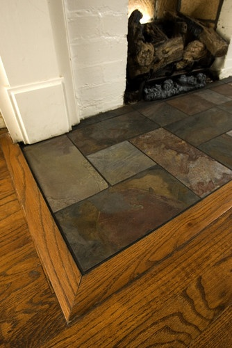 Fireplace Hearth Design, Pictures, Remodel, Decor and Ideas - slate fireplace surround perfect to cover up the original tiles we don't want to remove that don't fit our colour scheme.