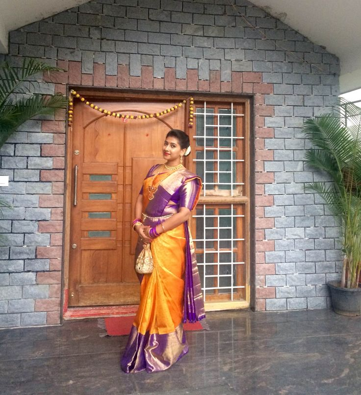 @ujjwala_n Traditional South Indian Couple. Silk saree drape Yellow purple Silk saree Smiling couple candid kanchivaram southindian hairstyle couple wedding bridal bride jewellery gold couple photoshoot dhoti sherwani dress.