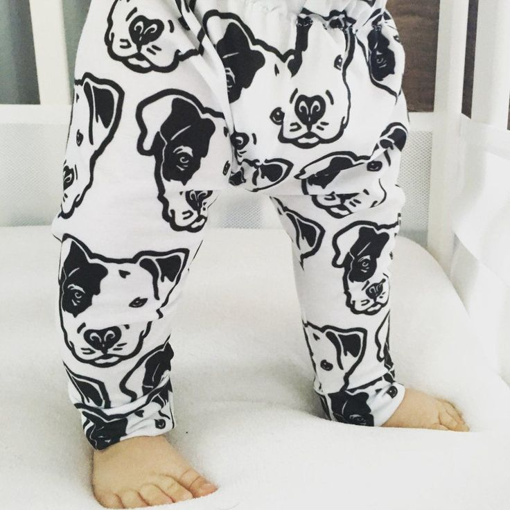 These adorable white leggings feature black Pit Bull faces, with a patch on the eye. Super cute and fun for a baby boy or baby girl. These leggings are made out of a lightweight and extremely soft jer