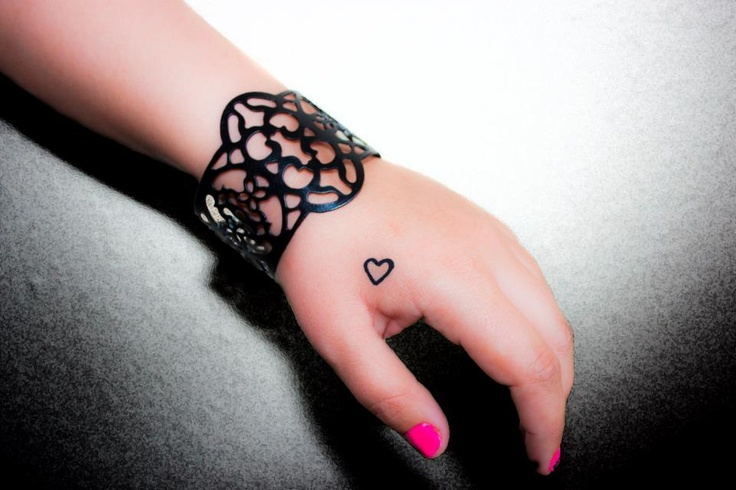 Heart tattoo on hand- we'll get matching hand tattoos like this for sure! no more drawing it in pen! :)