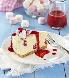 White Chocolate, Marshmallow and Raspberry Cheesecake - This Christmas cheesecake is so pretty and such fun. Fresh berries are best in the cheesecake but fresh or frozen may be used for the sauce.