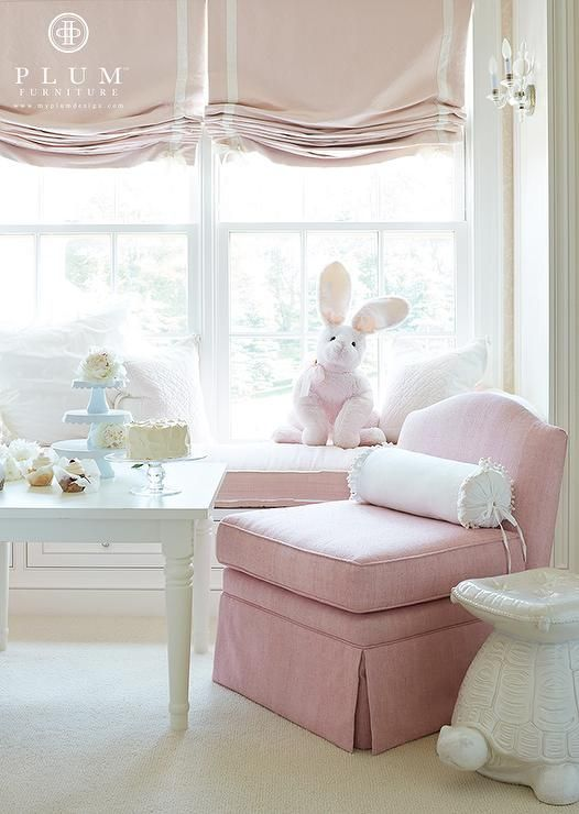 window seat with gorgeous mini chandelier lighting fixtures mounted on either side. I love that bunny too!!