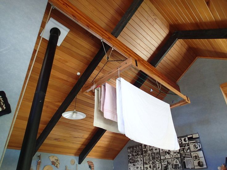 Clothes drying rack on a pulley - can hang clothes from ceiling above wood stove.