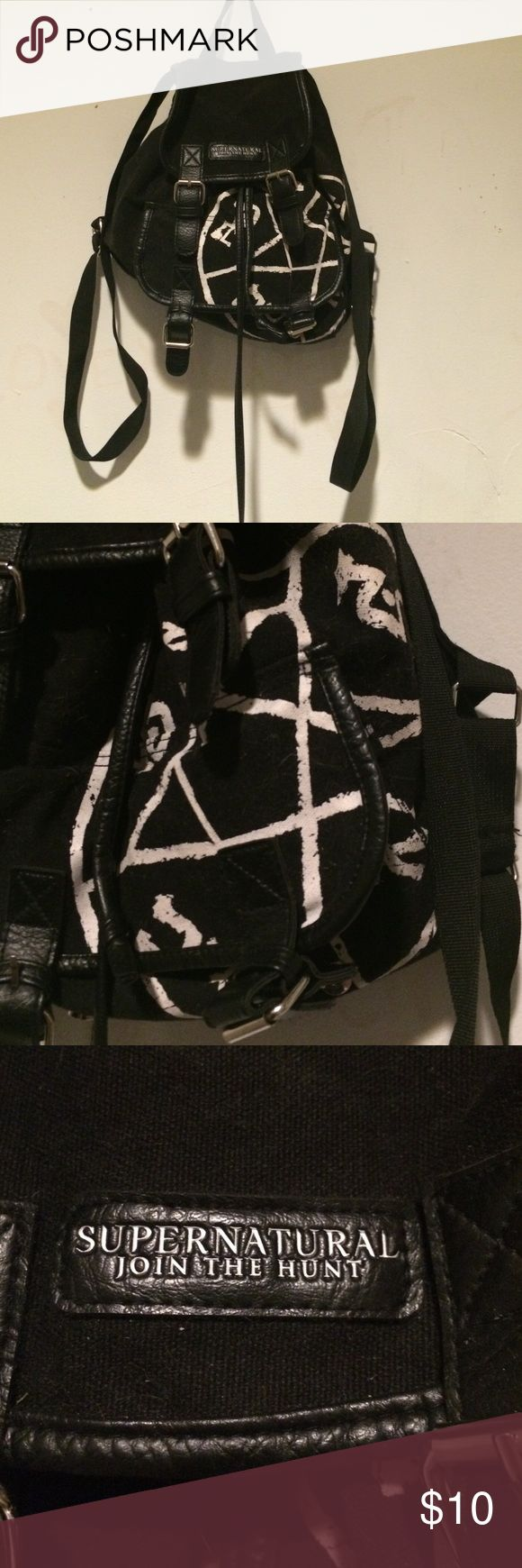 Supernatural backpack This is a black supernatural backpack. It has been sitting in my closet so it is a little dusty. I have a cat. So there is some hair on it . Hot topic  Bags Mini Bags