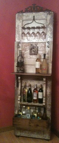 Rustic wine rack- love this!! Well that door I made into a headboard may be made into this now!