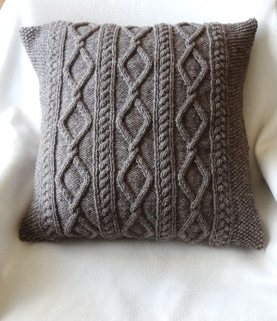 Hand knitted Cable Aran cushion cover in Taupe with flower-fabric buttons 45 x 45cm  £40.00 GBP  Handmade Materials: Wool, Acrylic, Cotton  Ships worldwide from Cambridge, England