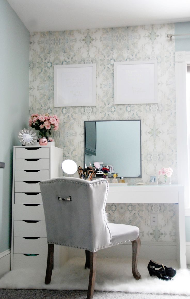 Beauty/vanity area tour with anthropologie wallpaper and IKEA malm dressing desk and IKEA Alex drawers. White furry rug and upholstered beauty chair completes the space. Via: Laura Elizabeth Lifestyle