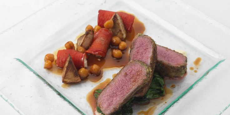 Herb crusted lamb is served with chickpeas, artichoke, tomato and goat's cheese in this brilliant lamb loin recipe from top chef Phil Carnegie