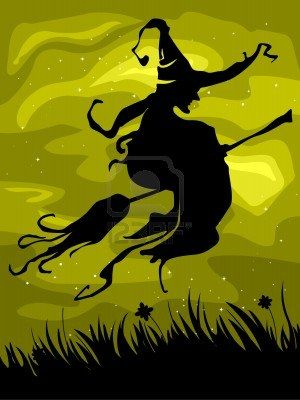 Silhouette of a Witch on Her Flying Broomstick Against a Yellowish Background