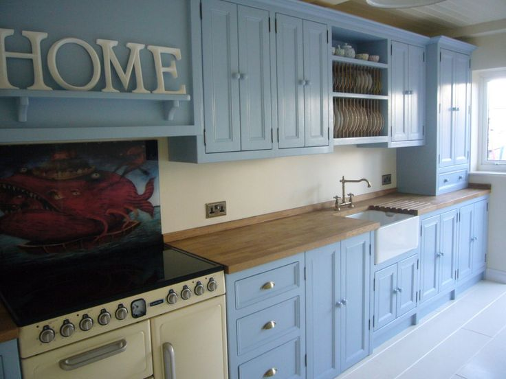 Cream Range Cooker With Lulworth Blue Painted Units