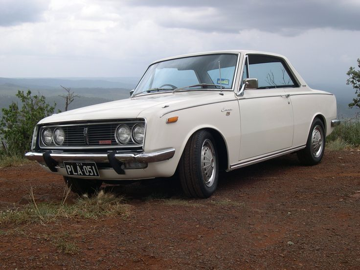 rare vintage RT51 toyota corona coupe one of the familiys most loved cars  owned it- extremely sad to see it go  low K's + original   when we got it -it was red. John rubed it back to original paint work by hand. still had plastic on the seats!