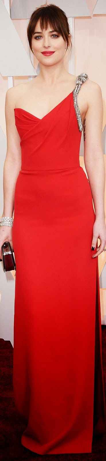 Dakota Johnson steps out in a scarlet Saint Laurent gown with crystal-embellished strap. 2015 Oscar Red Carpet