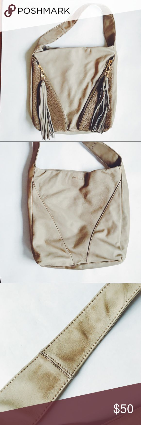 """Kelsi Dagger Issa taupe leather tassel hobo bag Soft taupe leather kelsi dagger hobo bag. Pebbled leather pockets, tassel zipper pulls. Clean interior. Darkening on strap and at corner, see photos. 13"""" w x 13.5"""" h x 2"""" d with an 8"""" strap drop. Kelsi Dagger Bags Hobos"""
