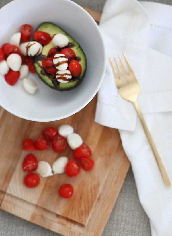 Caprese stuffed avocado | theglitterguide.com