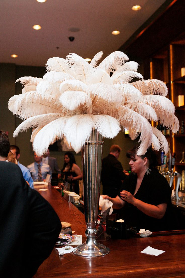 #feathers, #centerpiece  Photography: L Photographie - lphotographie.com Wedding Planning: Dishy Events - dishyeventplanning.com/  Read More: http://stylemepretty.com/2012/12/26/st-louis-art-deco-wedding-from-l-photographie/