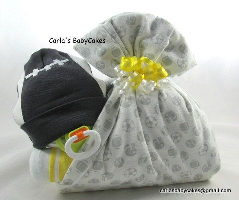 Stork bundle baby | Boy diaper cake | Stork bundle | Sports football diaper cake | Baby shower gift | Unique baby gift |  Baby sprinkle gift by MsCarlasBabyCakes on Etsy