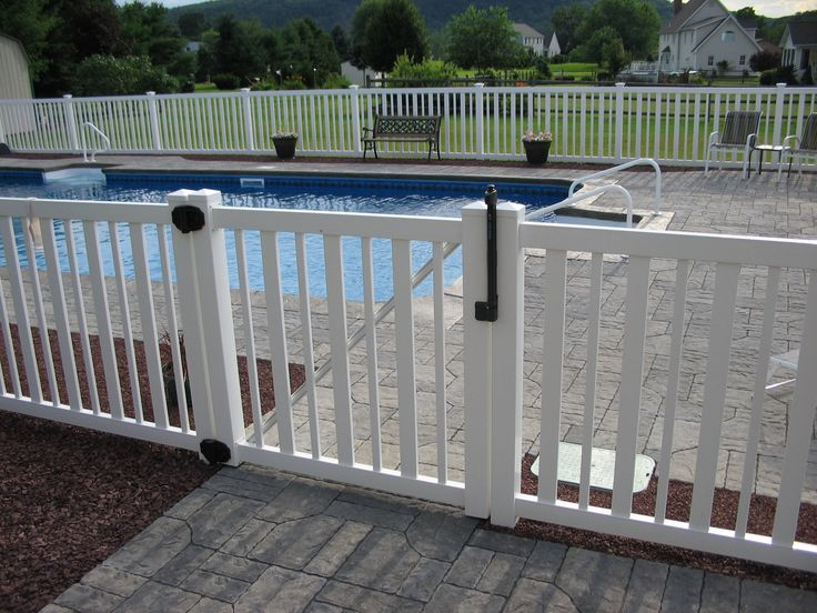 Top pull latch on a pool fence keeps your little ones safe. Weatherables Atlantis Pool Fence