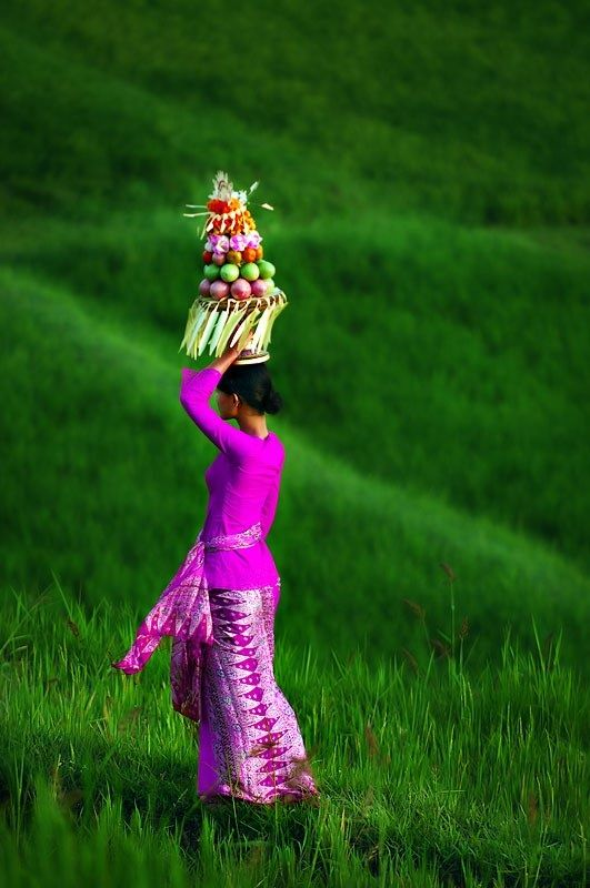 Bali -- Walking through the countryside near Ubud, we saw a group of women walking to a temple, carrying offerings on their heads.  I was invited to go with the women into the temple and was lucky enough to be there during the ceremony.  It was magical!