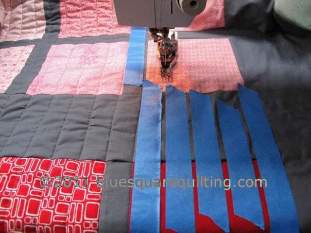 "Catherine explains: ""To keep the quilting lines straight and even, use blue painter's masking tape to mark line guides.  You can reuse several times before replacing.  Brilliant!"