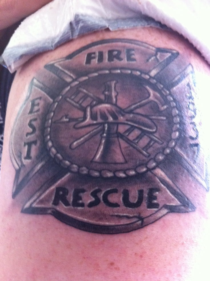 Tattoo on my son arm of the firefighter Maltese Cross. The