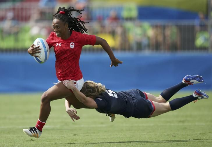 OLYMPICS-RIO Charity Williams of Canada is tackled by Danielle Waterman of United Kingdom during the rugby. REUTERS/Alessandro Bianchi