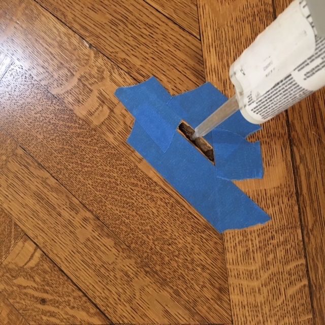 Repair Hole In Damaged Hardwood Floor Wood Floor Repair Hardwood Floor Repair Home Repairs