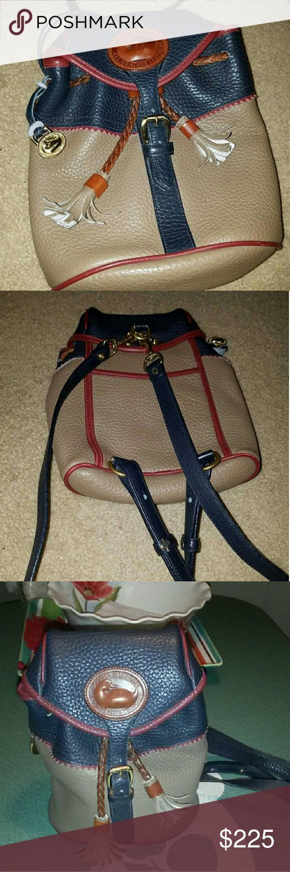 *flashSale2day* Vintage Dooney & B Teton backpack Rare and exceptionally good condition for a beautiful Vintage Teton backpack. The colors are dark Taupe & Navy with Rouge piping. No scuffs, stains. Piping in great shape, colors vibrant. Size 9.5in x 8.5in Dooney & Bourke Bags Backpacks