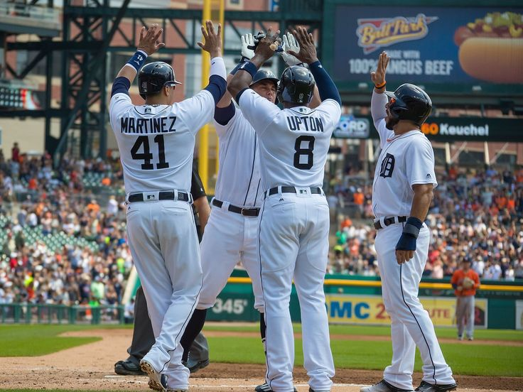 James McCann celebrates his grand slam in the bottom of the first inning with teammates Victor Martinez, Justin Upton and Mike Aviles, 07/31/2016