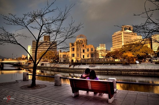 On a park bench beside the A-bomb Dome. :: I sat on a park bench in Hiroshima, just like this one but across the river, beside the A-Bomb Dome. Sitting there, I tried to imagine what it would have been like to be sitting there one sunny morning at  8:15AM, August 6th , 1945. (Photography by Geoffrey Liau @ http://www.flickr.com/photos/geoffrey-liau/4452823024/ )
