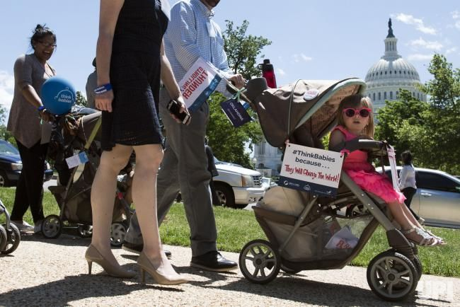 Families take park in Strolling Thunder, a march around the Capitol Building to highlight the need for improving early childhood…