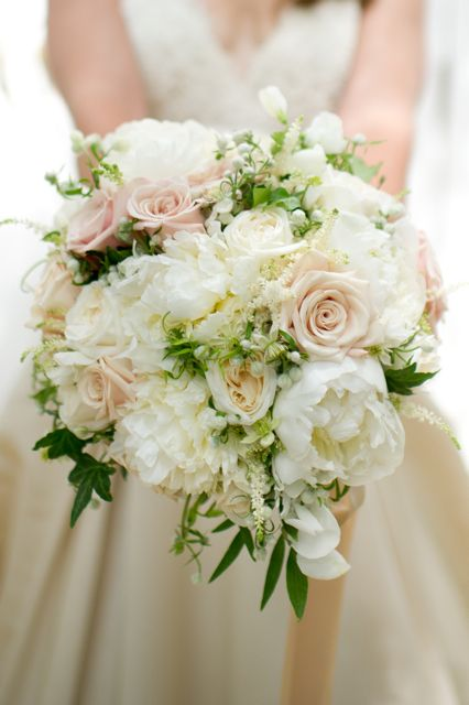 fabulously cream bouquet of peonies, white astilbe, white sweet peas, white ohara roses, and Japanese white clematis. Sahara roses were used to give the bouquet a bit of depth and warmth
