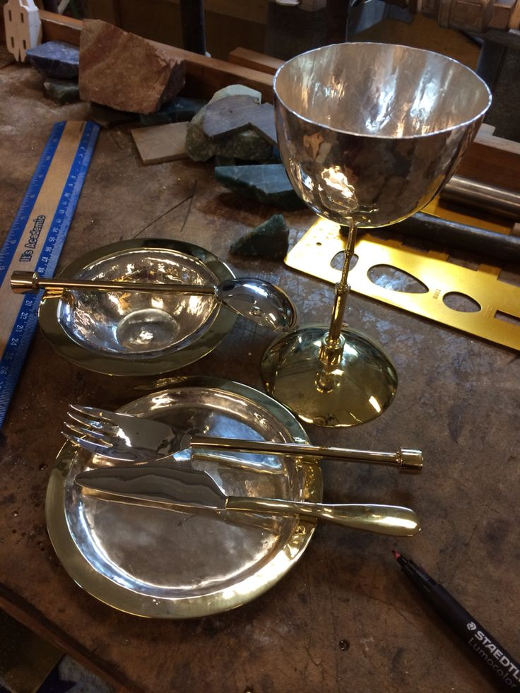 Sterling silver and brass personal dining set (cup, plate, bowl, fork, spoon, butter knife). Raised and sunk with elements fabricated with a metal lathe. For sale!