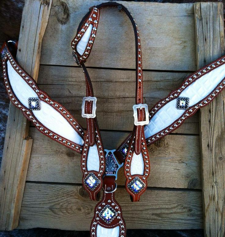 A pair of brown  white reins would look really sharp with this set!